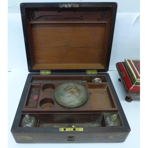 621 - A gentleman's rosewood and brass bound travel box and two tins...