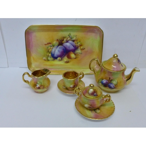 624 - A hand decorated dolls house tea service...