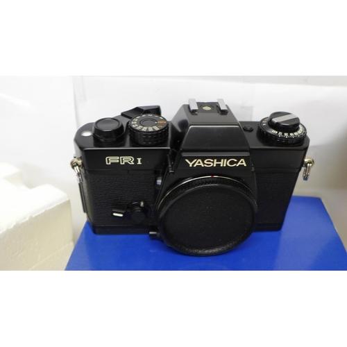 627 - A Yashica FRI SLR camera body, a Yashica 50mm f1.7 standard lens and a Sunpak Gx28 electronic flash ...