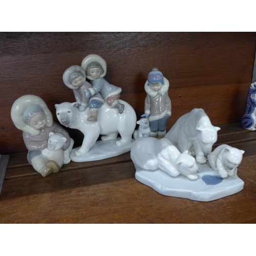 638 - Four Lladro figures, Eskimo Playing, no. 1195, Bearly Love, No. 1443, Eskimo Boy with Pet, No. 5238,...