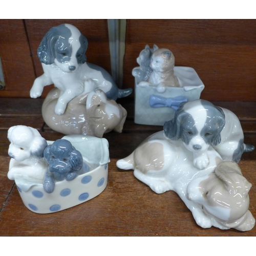 641 - Four Nao by Lladro figure groups, Kittens in a Basket, Poodles in a Polka Dot Box and two puppy figu...