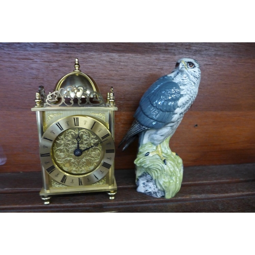 646 - A brass lantern clock with battery movement and a Beswick Merlin Beneagles decanter, (lacking conten...