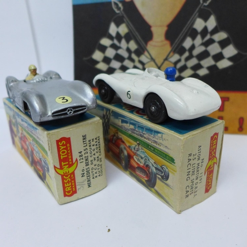 647 - Three Crescent Toys model racing cars, two boxed and one unboxed, and a Grand Prix Cars shop adverti...