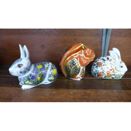 649 - Three Royal Crown Derby paperweights, Squirrel, Meadow Rabbit and Springtime Rabbit, all with gold s...