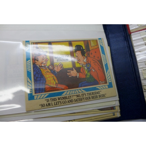 661 - A collection of humorous postcards in two flip over albums, vintage to modern (64)...