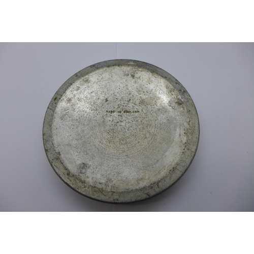 665 - An ashtray marked 'Made from a Rolls Royce Merlin engine piston as used in the Battle of Britain Aug...
