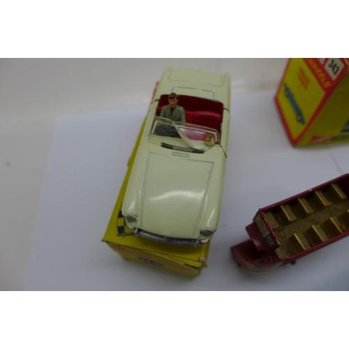 666 - A Dinky Toys 113 MGB Sports Car, boxed, a/f damage to windscreen, a Corgi Pontiac Firebird 343, boxe...