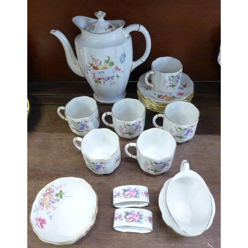 673 - A Royal Crown Derby Derby Posies six setting coffee set and two napkin rings...