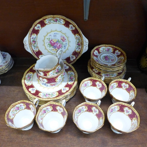674 - A Royal Albert Lady Hamilton tea set, six setting, with six cups, saucers, tea and side plates, cake...