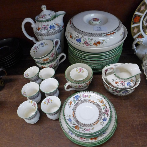 676 - Copeland Spode Chinese Rose teawares, cups, saucers, side plates and seven egg cups and saucers...