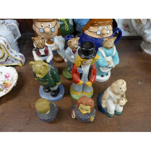 678 - A collection of Wade figures including two Nat West pig money banks, Tetley figures, Collectors Club...