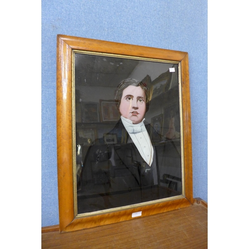 23 - A Victorian half portrait of a gentleman, reverse painting on glass, 54cms x 41cms, framed...