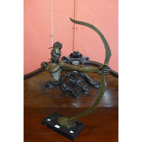 39 - A bronze figure of a Native American and bow...