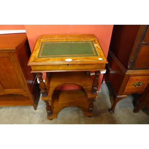 43 - A Victorian walnut Davenport writing desk...
