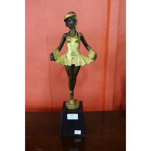 63 - An Art Deco style gilt bronze figure of a ballerina, on black marble socle...