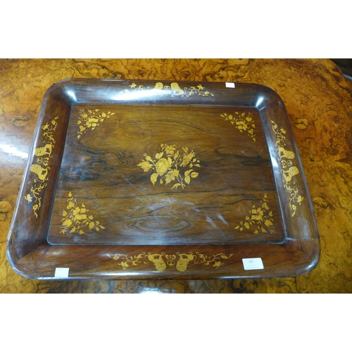67 - A Victorian inlaid rosewood tea tray...