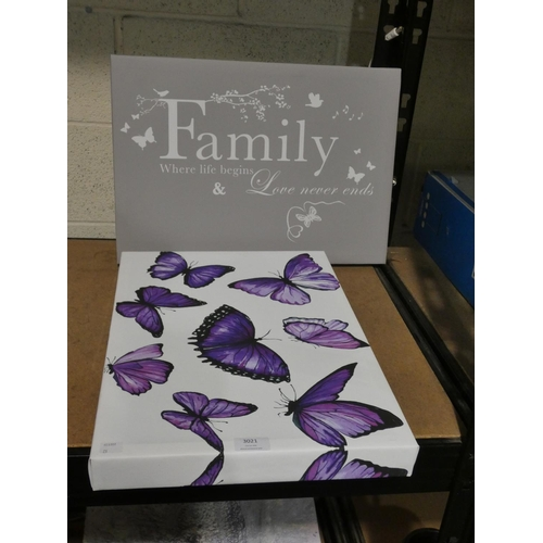 3021 - A purple butterfly print of canvas and a family print on canvas * This lot is subject to VAT...