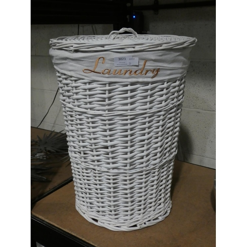 3023 - A white wicker style laundry basket * This lot is subject to VAT...