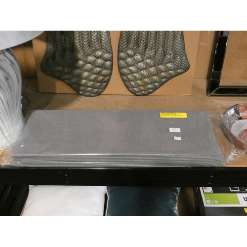 3033 - A pack of grey fabric adhesive squares * This lot is subject to VAT...
