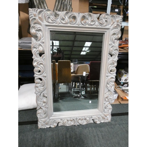3041 - A Lemoure Rocco style carved framed mirror * This lot is subject to VAT...