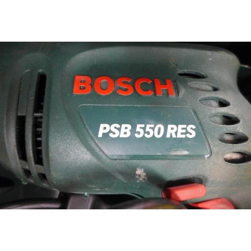 2027 - Bosch 240v hammer drill in case - W...