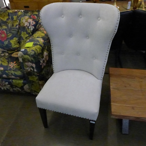 1330 - A cream upholstered side chair * This lot is subject to VAT...