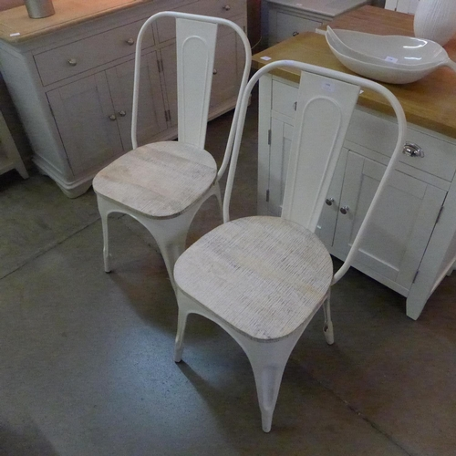 1406 - A pair of Tolix style side chairs * This lot is subject to VAT...