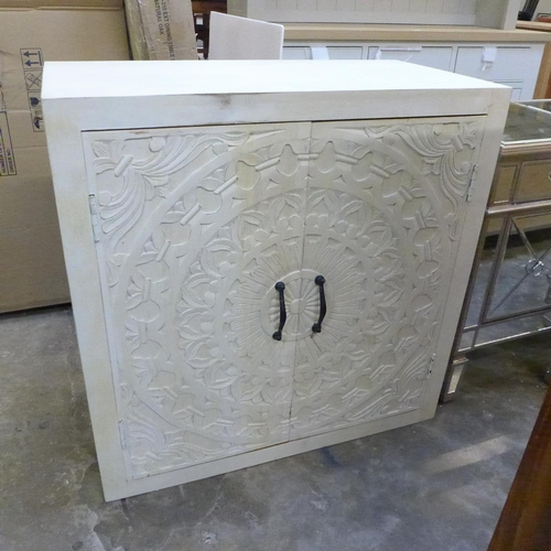 1999 - A painted hardwood two door cabinet  *This lot is subject to VAT...