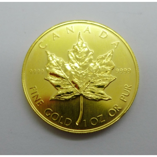 1055 - A Canadian gold Maple, 1oz 999.9 fine gold 1985 50 Dollars coin...
