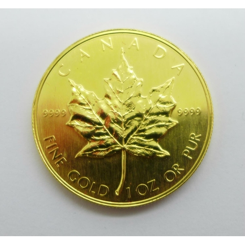 1073 - A Canadian gold Maple, 1oz 999.9 fine gold 1985 50 Dollars coin, 31.2g...