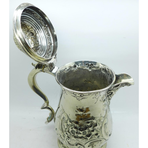 602 - A Victorian silver plated embossed tankard, 21cm...