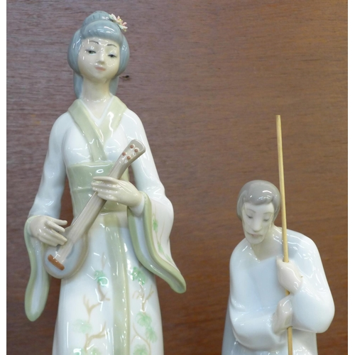 607 - A Lladro Nativity figure of Saint Joseph, no. 4533 Ovation, Don Quixote, no. 5357 (missing sword) an...