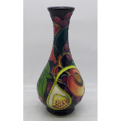 612 - A Moorcroft vase (shape no. QC80/6) Queens Choice pattern, 17cm...