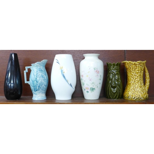 622 - Six vases including Wedgwood, Poole and Sylvac, (blue and yellow jugs a/f)...