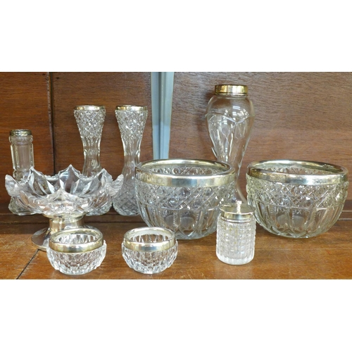 664 - A collection of silver mounted glass items (10)...