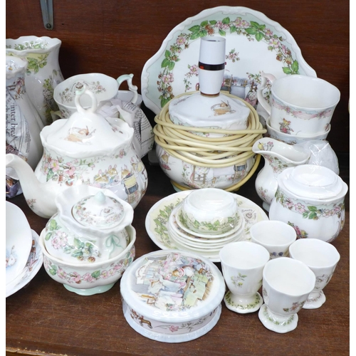 704 - A collection of Royal Doulton Brambly Hedge tea and dinnerwares, a lamp base, clock, etc., some piec...
