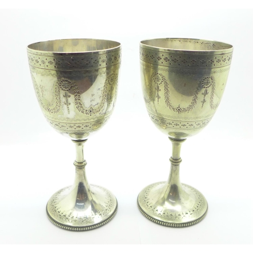 840 - A pair of silver plated engraved wine goblets...