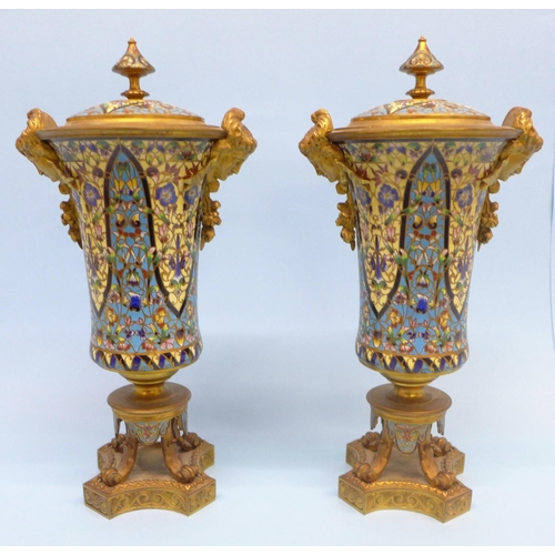 841 - A pair of French champlevé enamel and ormolu trumpet shaped vases, each with mask mounts and flared ...