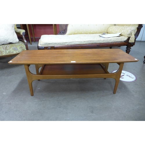 145 - A teak coffee table...