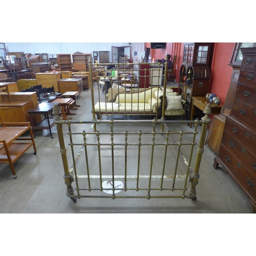 49a - A Victorian brass double bed...