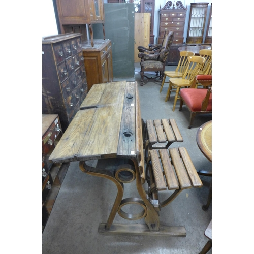 50 - A Victorian pine and iron school desk...