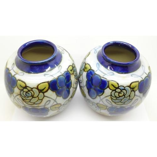 606 - A pair of Royal Doulton stoneware vases, 14cm...