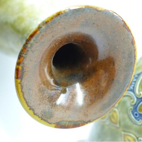 610 - A pair of Royal Doulton saltglaze relief moulded vases, 27cm