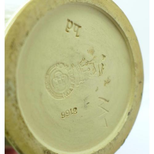 610 - A pair of Royal Doulton saltglaze relief moulded vases, 27cm...