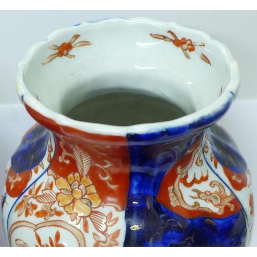 619 - A pair of Imari vases, 30cm