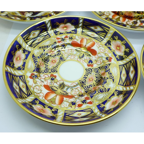 620 - A set of six Royal Crown Derby 2451 coffee cans and saucers...