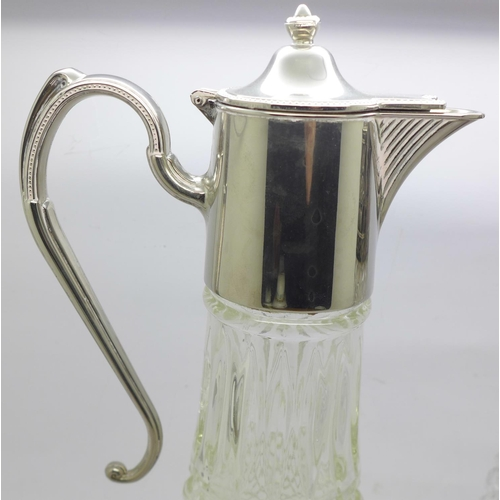 623 - Two claret jugs with plated tops, (one with cracked glass, jug on the right in the image)...
