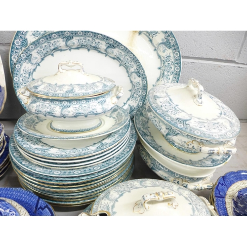 625 - A large blue and white willow pattern meat platter, a/f, one smaller, Booth's Real Old Willow patter...