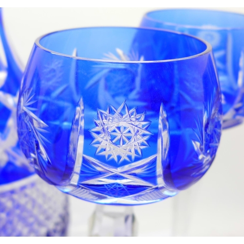629 - A blue flash cut crystal decanter and six hock glasses...