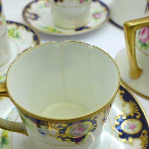 630 - A Kokura Japanese six setting coffee set with cream and sugar, three coffee cans a/f...